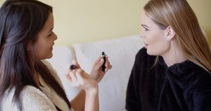 Kind Friend Helping a Woman in Putting Make up stock footage