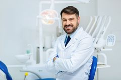 Kind hearted glance of professional dentist