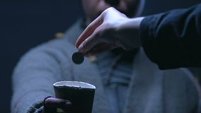 Kind hearted person donating cents to beggar holding cup, charity to homeless. Stock footage stock video footage