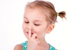 Kind het plukken neus royalty-vrije stock foto