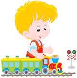 Kind het spelen met een trein vector illustratie