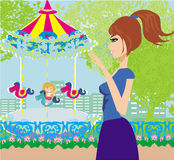 Kind het spelen op de carrousel stock illustratie