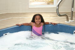 Kind in Hottub stockfoto