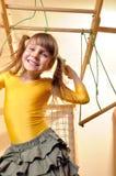 Kind an ihrer Ausgangssportausrüstung Stockbilder