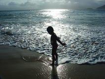 Kind im Schattenbild Stockbild