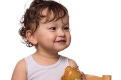 Kind isst Apfel. Lizenzfreie Stockfotografie