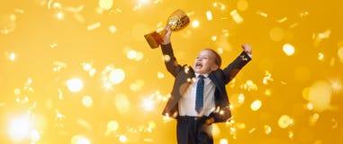 Kind ist Sieger lizenzfreie stockfotos