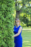 Kind lady in the bushes looking directly Royalty Free Stock Photo