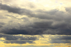 Kind of leaden clouds. Panorama of gray clouds illuminated from above by rays of the sun Stock Photo