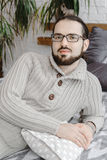 Kind look young handsome spectacled man with beard portrait Royalty Free Stock Image