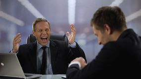 Kind male boss and employee laughing and shaking hands during conversation. Stock footage stock footage