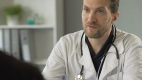 Kind male therapist consulting patient, prescribing medication, health care stock footage