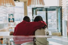Free Kind Man Hugging His Girlfriend While Being In The Cafe With Her Stock Photo - 129378320