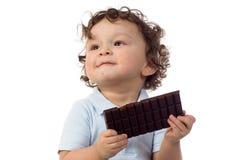 Kind met chocolade. royalty-vrije stock afbeeldingen