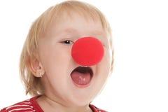 Kind met clownneus Stock Afbeeldingen