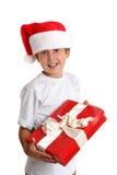 Kind met de gift van Kerstmis stock foto