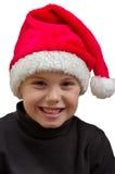 Kind met de hoed van de Kerstman Stock Fotografie