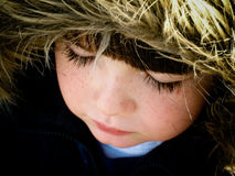 Kind met EskimoHoed Stock Foto