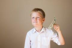 Kind met geld (20 dollars) Royalty-vrije Stock Afbeeldingen