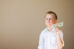 Kind met geld (20 dollars) Stock Foto's