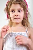 Kind met hoofdtelefoons Stock Foto's