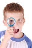 Kind met loupe Stock Foto