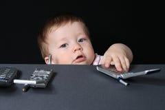 Kind met mobiele telefoons royalty-vrije stock fotografie