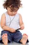 Kind met mp 3 speler. Royalty-vrije Stock Fotografie