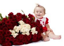 Kind met rozen Stock Foto