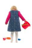 Kind met verspreidingsstuk speelgoed stock afbeeldingen