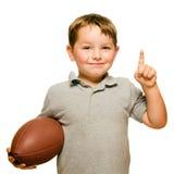 Kind met voetbal het vieren Stock Foto's