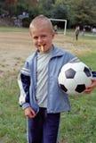 Kind met voetbalbal royalty-vrije stock foto's