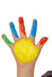 Kind mit dem Finger malt Farben Stockbild