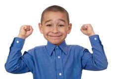 Kind mit den Fäusten angehoben, Sieg Stockfotos