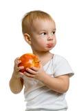 Kind mit einem Apfel Lizenzfreie Stockfotografie