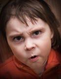 Kind mit einem sauren Gesicht Lizenzfreie Stockfotos