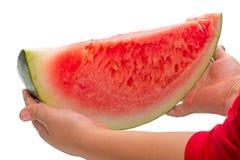Kind mit einem Stück der Wassermelone Stockbilder