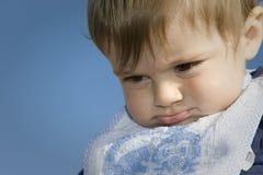 Kind mit einer Missgunst lizenzfreie stockfotos
