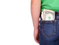 Kind mit Geld in der Tasche Stockbild