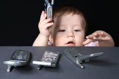 Kind mit Handys Lizenzfreie Stockfotografie