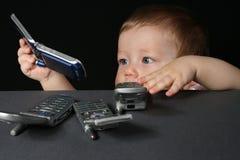 Kind mit Handys Stockfotografie