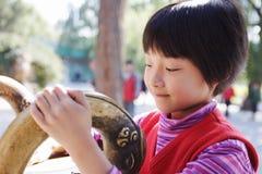 Kind mit Künsten Stockfoto