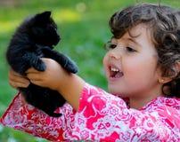 Kind mit Katze Stockbilder