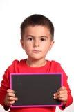 Kind mit leerer Tafel Lizenzfreie Stockbilder