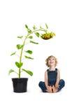 Kind mit Sonnenblume Stockfotos