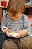 Kind mit Spielzeug Stockfotografie