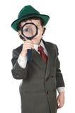 Kind mit Vergrößerungsglas Stockfotos