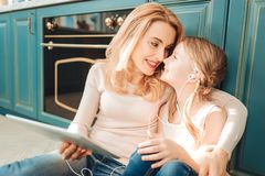 Kind mommy touching nose of her kid stock photos