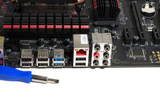 Kind of motherboard on the side with tools and parts for repair.  royalty free stock image