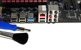 Kind of motherboard on the side with tools and parts for repair.  royalty free stock photos